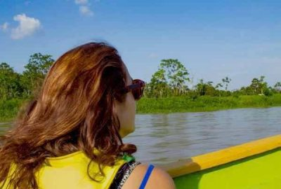 Woman-on-boat-to-Macaw-clay-lick-A-600x570